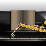 Piano front view close-up and saxophone Royalty Free Stock Images