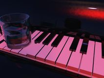 Piano & Glass. A liquor glass sits atop a piano in a sleazy bar Royalty Free Stock Photos