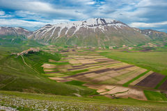 Piano Grande scenic fields and Sibillini mountains in Umbria, It Stock Image