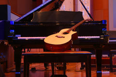 Piano and guitar. Pose together Royalty Free Stock Photography