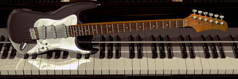 Piano and guitar. Panoramic front view of a piano keyboard and an electric guitar on it stock photo