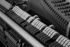 Piano hammer striking strings Stock Photography