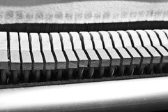 Piano Hammers. Closeup view of piano hammers at rest Royalty Free Stock Photography