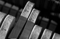 Piano hammers striking. Extreme closeup of piano hammers pushing towards strings Royalty Free Stock Image