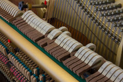 Piano hammers striking Stock Image