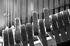 Piano hammers striking strings. From below Royalty Free Stock Photo
