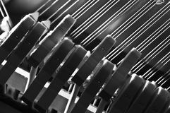 Piano hammers striking strings. From below Stock Photos