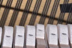 Piano hammers on strings Stock Photography