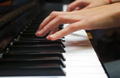 Piano hand. A left hand playing piano Stock Photo