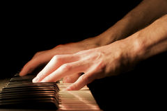 Piano Hand. A caucasian male's hand playing a keyboard Stock Image
