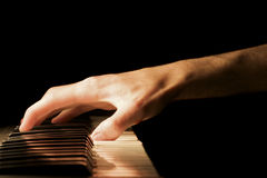Piano Hand. A caucasian male's hand playing a keyboard Royalty Free Stock Photo