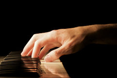Piano Hand. A caucasian male's hand playing a keyboard Royalty Free Stock Photos