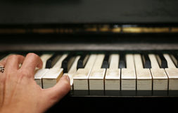 Piano and hand Stock Photos