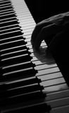 Piano with hand. Black and white piano with hand Royalty Free Stock Photos