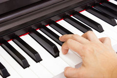 Piano and hand Royalty Free Stock Photos