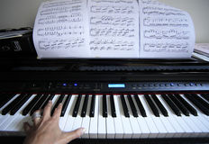 Piano and hand Stock Photo