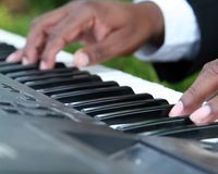 Piano and hands. Abstract close-up of a musician playing a song on a piano Stock Photography