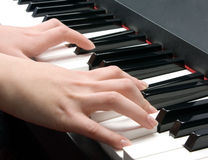 Piano and hands stock images
