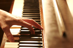 Piano Hands. A hand Playing the Piano Royalty Free Stock Photos
