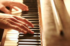 Piano Hands. A hand Playing the Piano Royalty Free Stock Images