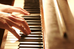 Piano Hands. Two hands Playing the Piano Stock Photo