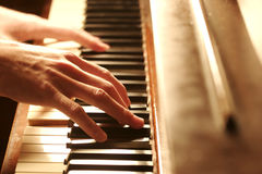 Piano Hands. A hand Playing the Piano Stock Photos