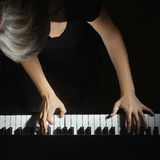 Piano hands on musical instrument Royalty Free Stock Photos