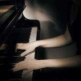 Piano hands on musical instrument Stock Photo