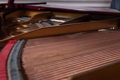 Piano harp interior of a piano royalty free stock photography