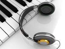 Piano with headphones Royalty Free Stock Image