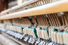 Piano inside close up. Action mechanics hammer close up inside of an upright piano Stock Image