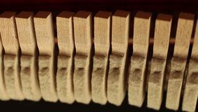 Piano inside hammers strings. Tuning pianos, felt hammers hit the strings of the instrument, Inside of a piano stock video