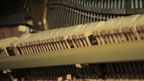 Piano inside, Internal structure of piano, hammers and keys. stock footage