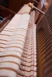 Piano. Inside of an old upright piano Stock Images