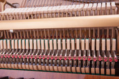 Piano. Inside of an old upright piano Royalty Free Stock Photo