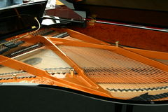 Piano Inside. Strings inside the black piano Royalty Free Stock Image