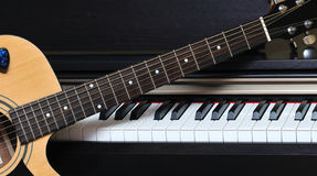 Piano key and guitar. Stock Images