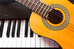 Piano key and guitar. Stock Photo