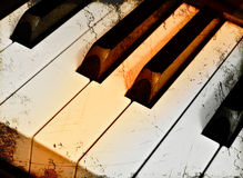 Piano key- middle C in grunge Royalty Free Stock Images