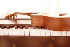 Piano key and ukulele Royalty Free Stock Photos