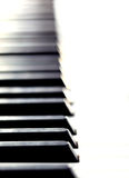 Piano Keyboard. In shallow depth of field giving a repeated pattern royalty free stock image