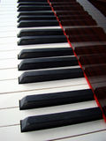 Piano keyboard background. Close up of a piano keybord stock image