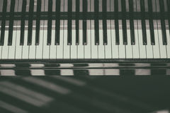 Piano keyboard background with selective focus. Blur keyboard and musical notes Royalty Free Stock Photography