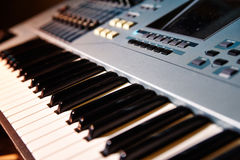Piano keyboard background with selective focus Stock Photos