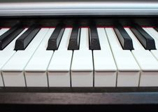 Piano keyboard close up. Elements of musical instrument. Lines and black and white colors of piano keyboard royalty free stock images