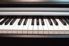 Piano keyboard close up. Elements of musical instrument. Lines and black and white colors of piano keyboard stock photo