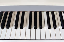Piano keyboard close-up. Orchestral music Royalty Free Stock Photography