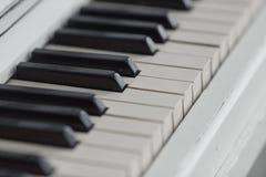 Piano keyboard closeup with. Stock Photos