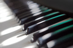 Piano keyboard. Closeup view of a piano keyboard stock photography
