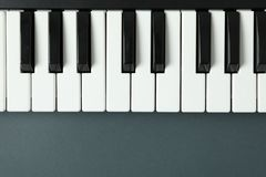 Piano keyboard on dark background. Space for text royalty free stock photography